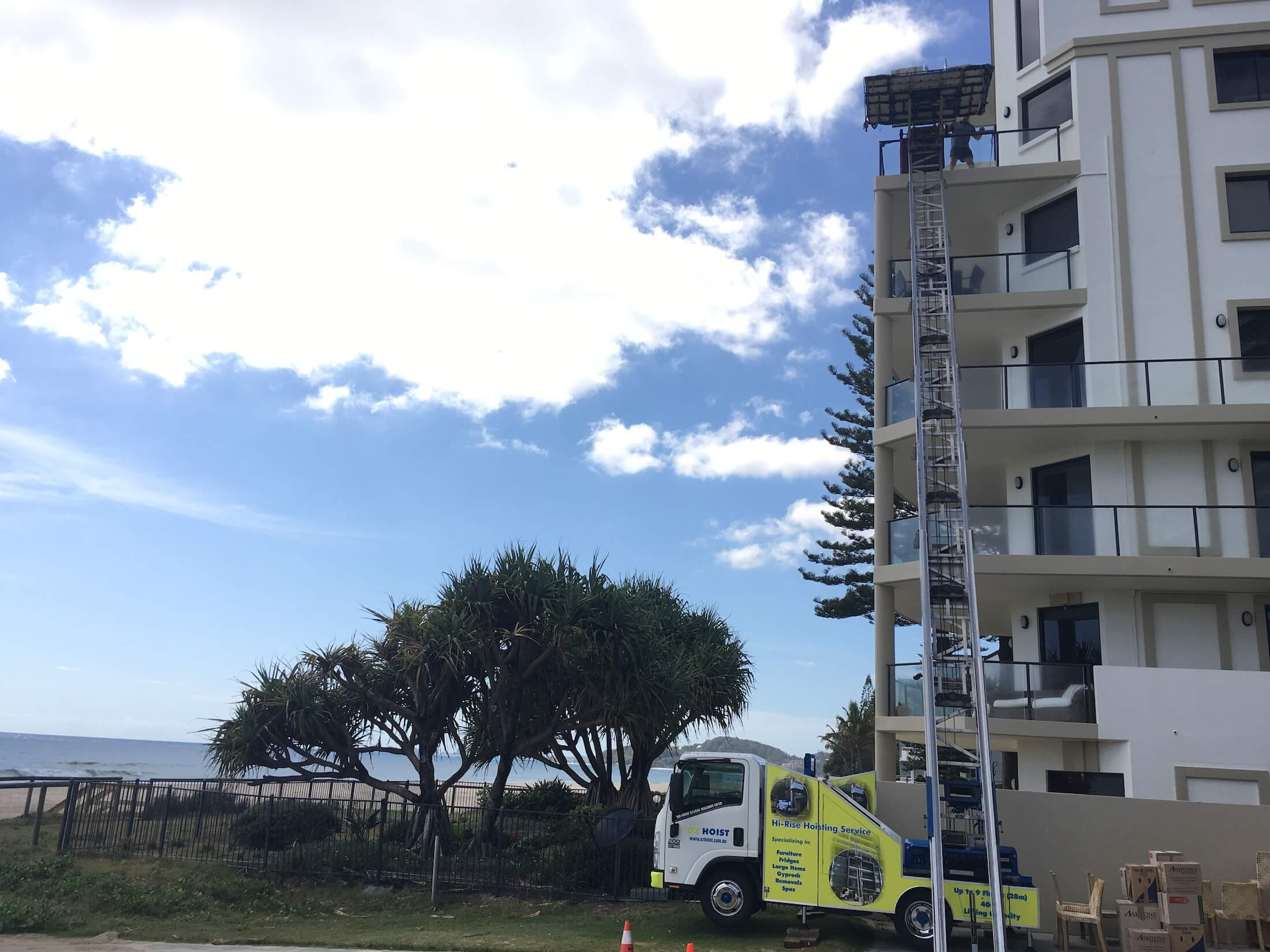 gold_coast_high_rise_apartment_lift_furniture_from_balcony_crane_hoist_lifting_up_to_9_storeys_for_units_house_townhouse