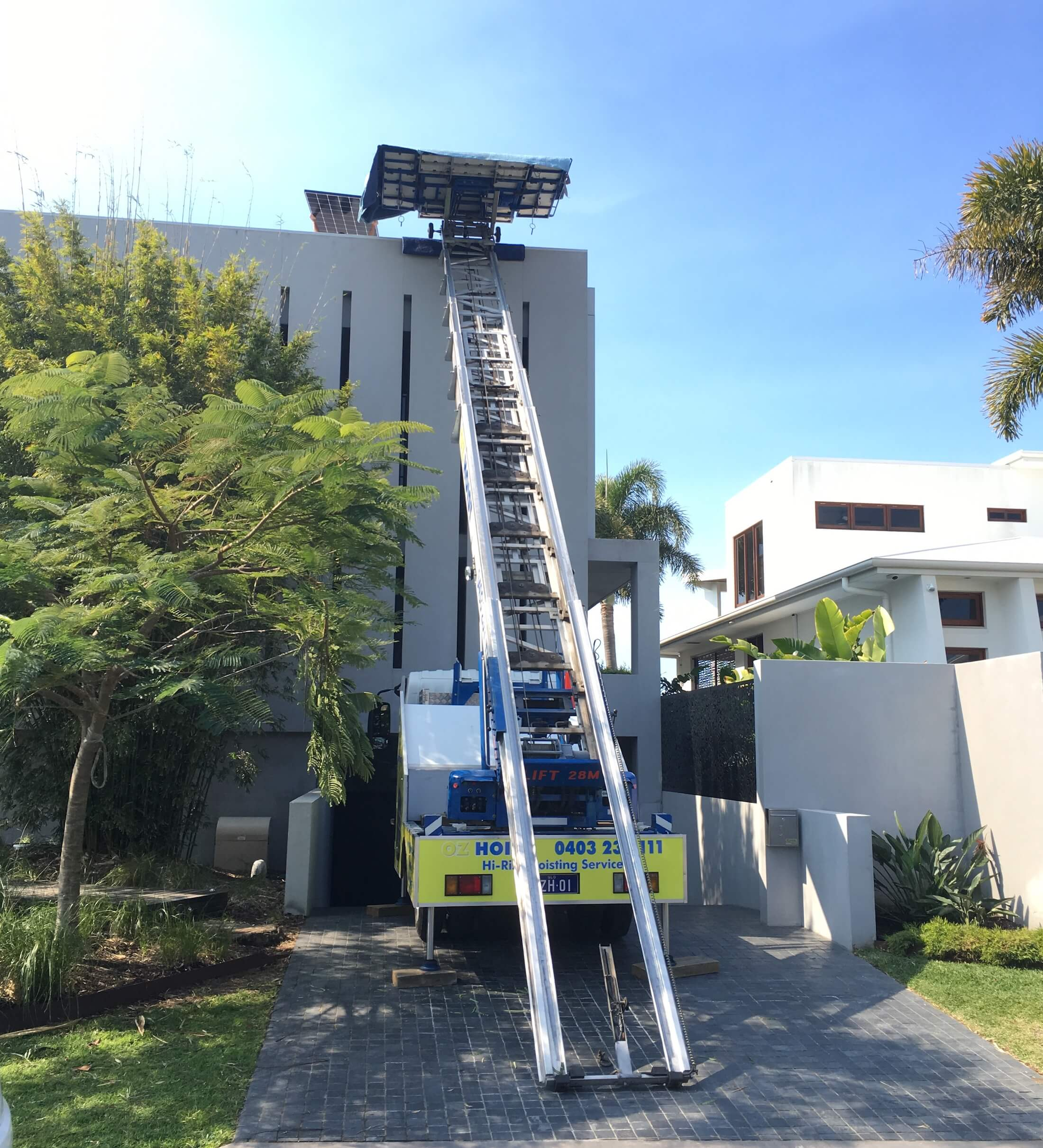 lift_and_move_building_supplies_to_the_roof_using_professional_truck_hoist_brisbane_gold_coast_sunshine_coast